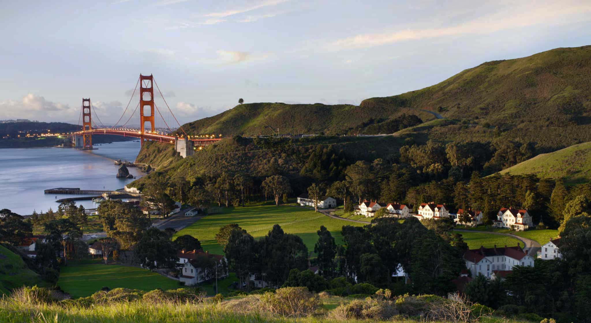 Exterior view overlooking the Cavallo Point Lodge at Fort Baker with the golden gate bridge in the background.
