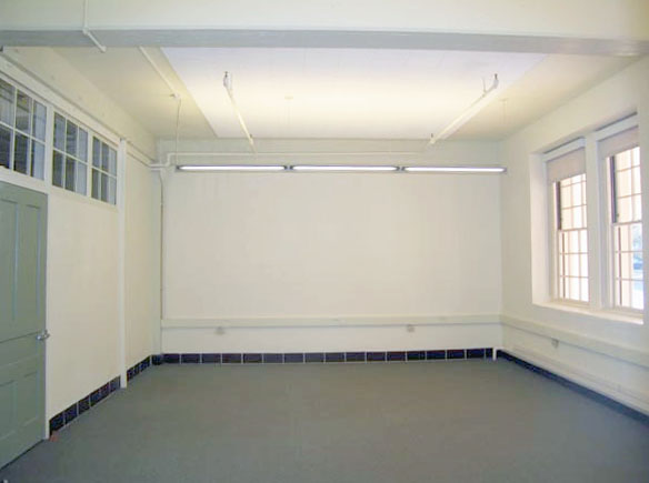 Image of interior of office with two windows.