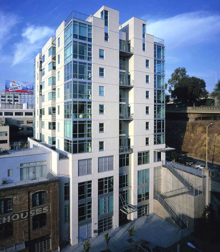 Exterior daytime view of 11-story residential structure modern architectural glass details