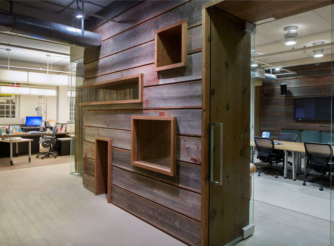 Suite 219 updated with rough-hewn wood cladding around a conference room entryway