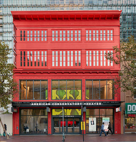 Exterior view of theater façade painted bright red along Market Street