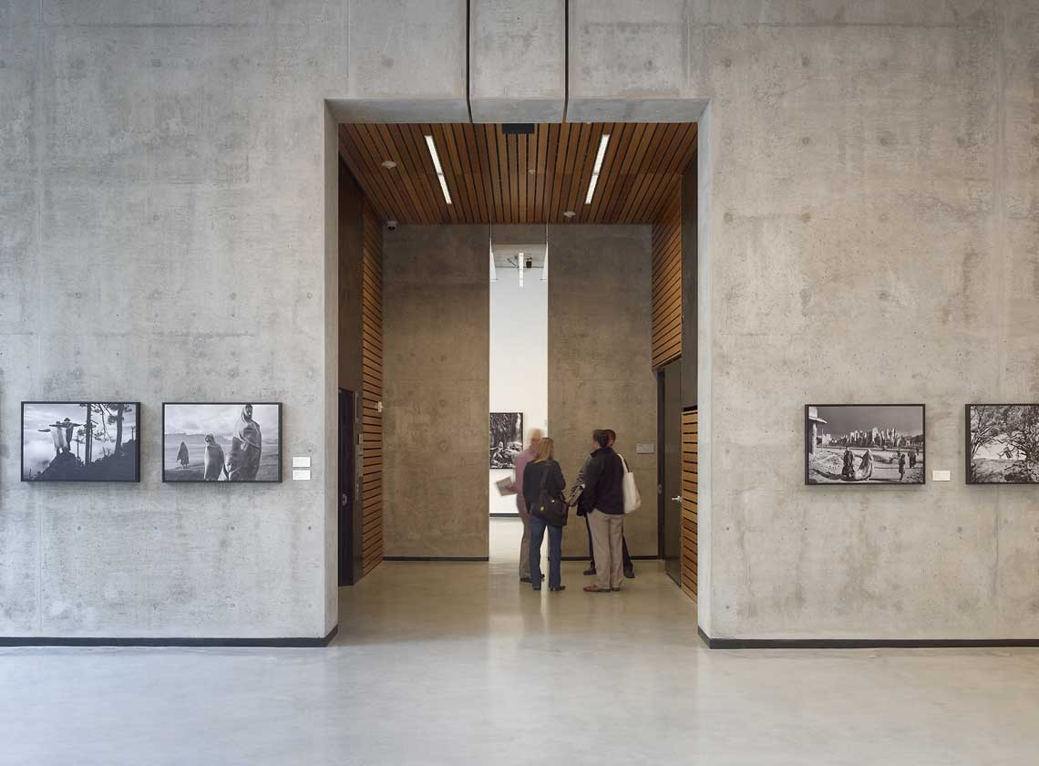 Interior view of lobby concrete walls and elevator lobby with wood cladding
