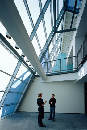 Interior view of modern glass atrium spanning lobby and corridor spaces on multiple floors