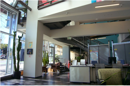 Interior daytime view of ground-floor entry, lobby, reception, and seating areas