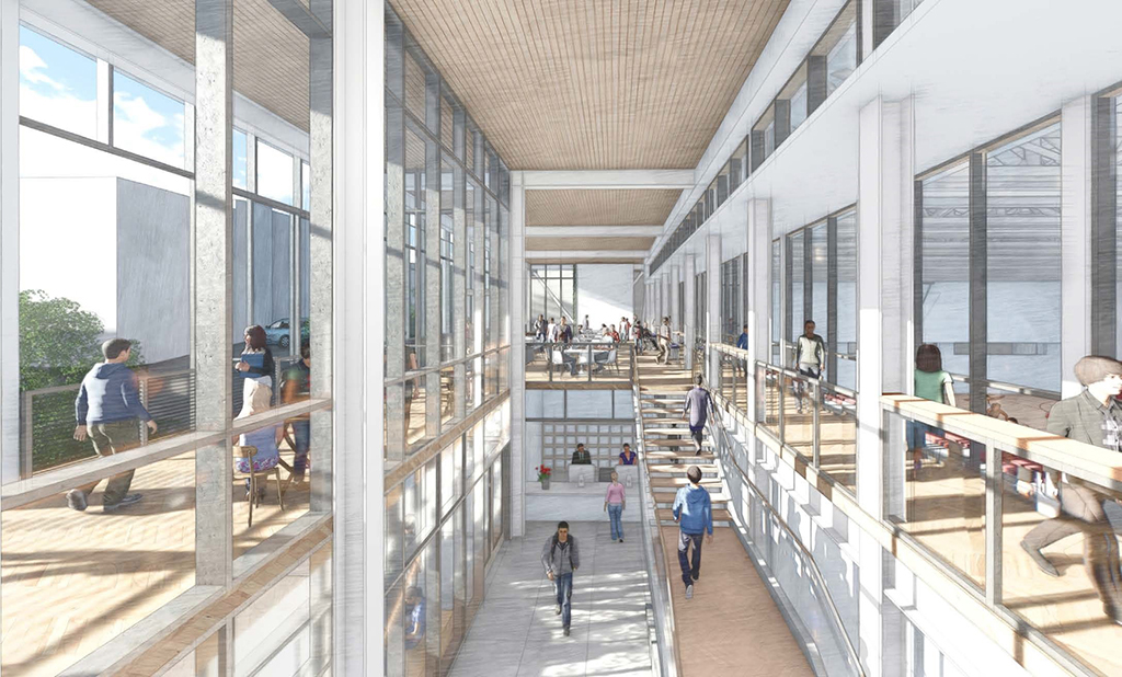 Rendering of interior double-height atrium with large glass windows, exterior balcony walkway, open gathering spaces