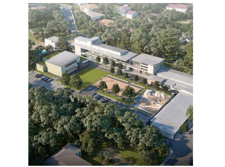 Bird's eye exterior rendering of school campus buildings, play area, basketball court, and lawn
