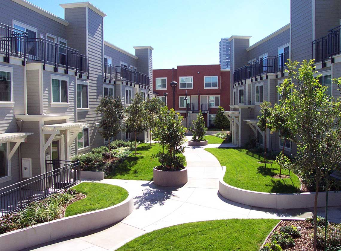 Exterior daytime view of landscaped courtyard with curving walkways and lawns